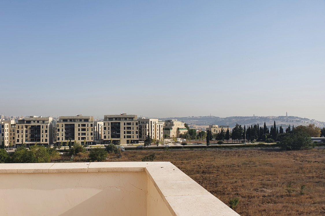 You will be able to look over the view of rolling hills everyday in the Jerusalem apartment in Arnona.